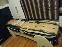 white and blue wooden semi-electric bed