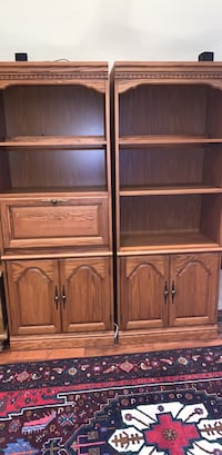 Two bookcases with cabinet doors , can be used as desk with pull down door.