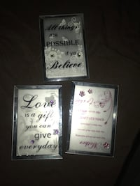 three assorted wall decors with black wooden frames Las Vegas, 89139