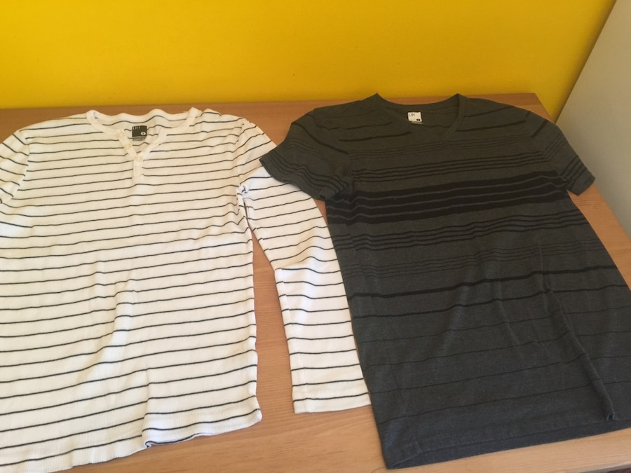 two black and white shirts
