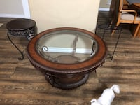 round brown wooden framed glass top coffee table Chula Vista, 91915