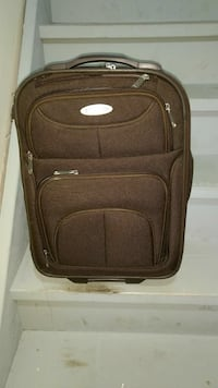 brown and gray luggage