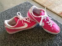 pair of pink Nike running shoes Cabot, 72023