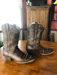pair of black leather cowboy boots Youngsville, 27596