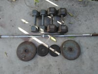 gray barbell and weight plates ANAHEIM