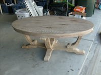 oval brown wooden dining table null