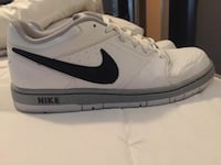 unpaired white and gray Nike mid top sneakers Adair, 74016