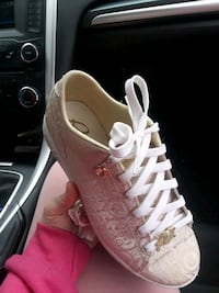 pair of white low top sneakers Davidsonville, 21035