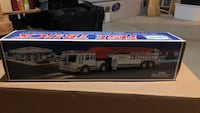 white and blue Hess truck toy box Severn, 21144