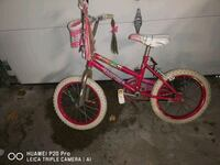 toddler's pink and white bicycle 590 km