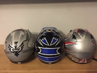 three white, blue, and red full face helmets Mississauga, L4Z 3W5