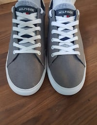 pair of gray Hilfiger sneakers Morden, R6M 1E3