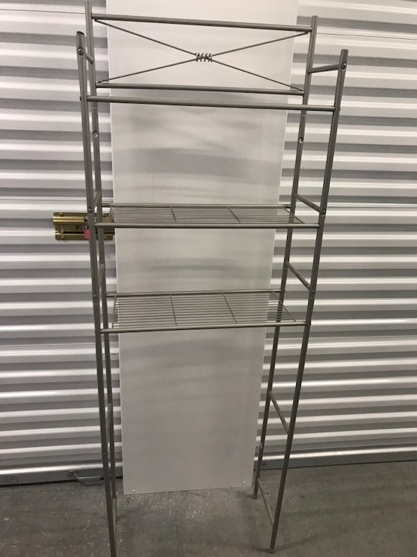 Over the toilet storage rack 1a1e70e5-a6d3-473e-8e79-e410cc0176e5