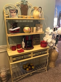 Bakers rack has two drawers and comes in two pieces. Very sturdy piece of furniture. Has a variety of uses and would make an awesome coffee bar drawers are lined inside and on the sides. 505 mi