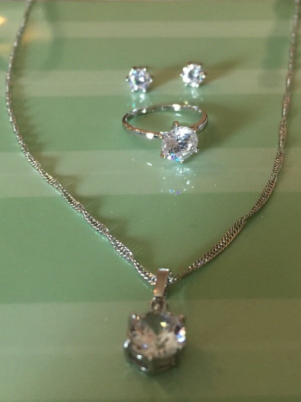 Set Of 3. Size 8 ring, a necklace and earrings to match. Great gift