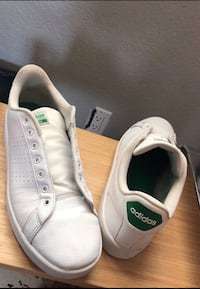 pair of white Converse low-top sneakers