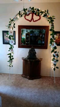 Wedding Arch with lights and flowers