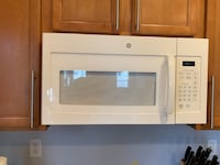 white General Electric microwave oven null
