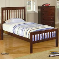 brown wooden bed frame with white and blue bedspread Lakeland, 33809