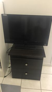 black wooden TV stand with flat screen television Toronto, M8V 1B5