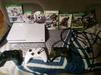 white Xbox One console with controller and game ca 80 km