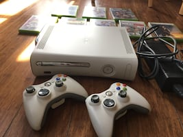 Xbox 360 with 2 wireless controllers, wifi adapter and 8 games