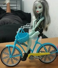 Monster High doll with bicycle toy