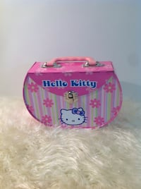 Hello kitty collectible tin Case: new, never used.