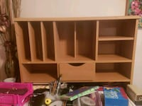 brown wooden TV hutch with flat screen television 549 mi