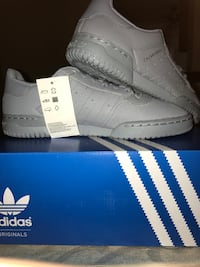 pair of gray Adidas Calabasas shoes with box