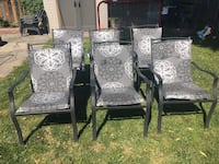 four brown wooden framed white padded armchairs Cambridge, N1R 6Z8