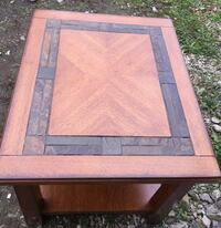 New, solid wood end table. Shipping damage on corner. Nice heavy table. Etna, 43062