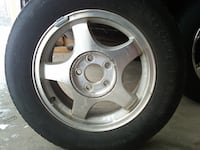 Gray 5-spoke car wheel with tire Clay, 13090