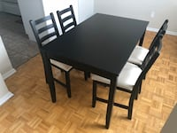 rectangular black wooden table with four chairs dining set Toronto, M3C 3N3