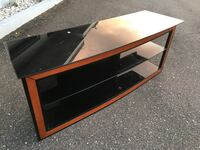 Black glass and brown wooden tv stand Pinellas Park, 33762