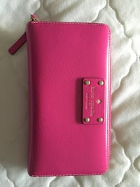 pink Kate Spade leather zip wristlet
