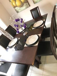 rectangular black wooden table with six chairs dining set Bradford West Gwillimbury, L3Z 0X4