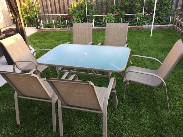 Patio Set. Table and six chairs.