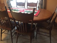 round brown wooden table with four chairs dining set Riverside, 92503
