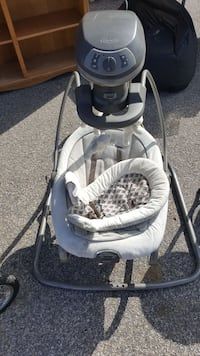 baby's white and gray Graco cradle and swing