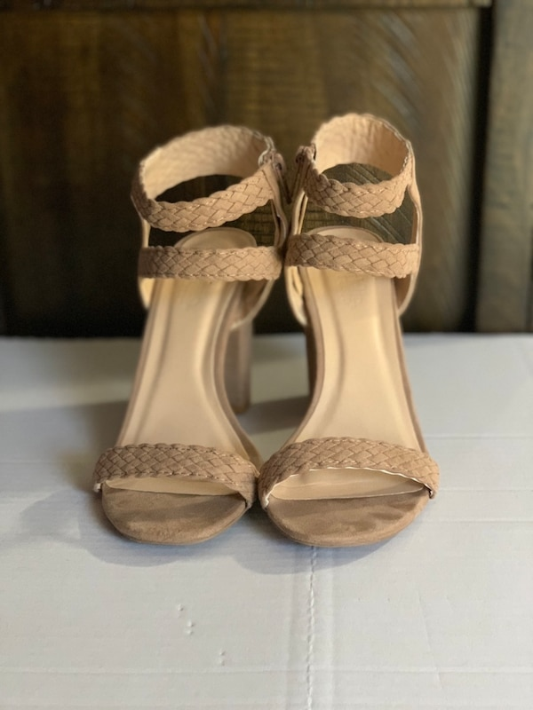 pair of brown leather open-toe heeled sandals
