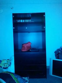 black wooden TV hutch with flat screen television