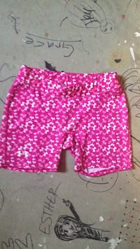 Medium pink and white under armour spandex shorts