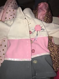 white, pink, and gray floral butotn-up jacket