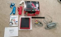 red Nintendo 3DS with game cases Manassas, 20110