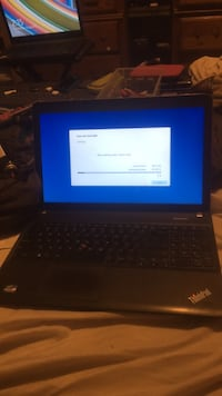 Black laptop computer with ac adapter Lake Elsinore, 92530
