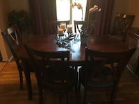 Ashley dining room set with hutch. Scratches on table, arms of 2 chairs were removed due to tight space, just needs to be screwed back on. The table also comes with a leaf.  261 mi