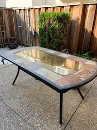 Outdoor dining table with umbrella holder