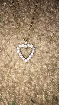 Diamond encrusted heart pendant necklace with gold-colored chain