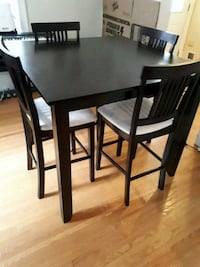 rectangular black wooden table with four chairs dining set Peterborough, K9J 2G2